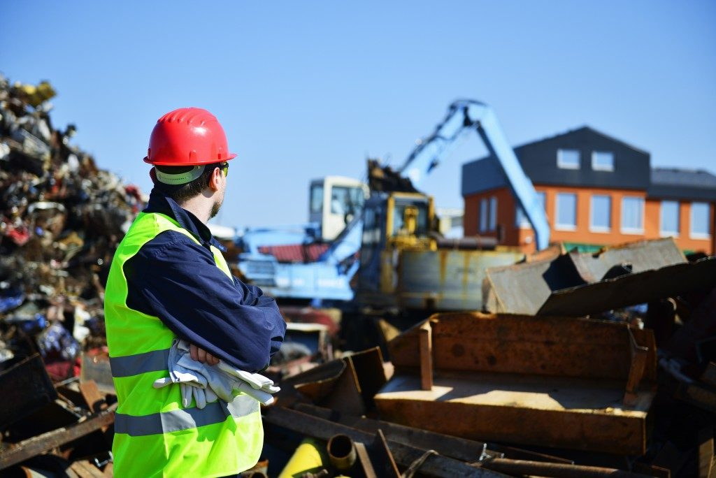 construction worker managing waste at site