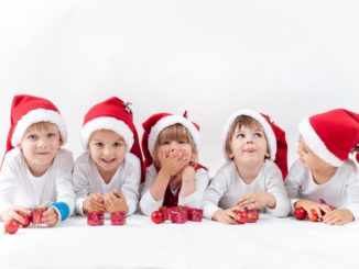 kids wearing santa hats