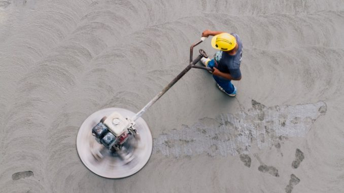 aerial view of a worker flattening a concrete