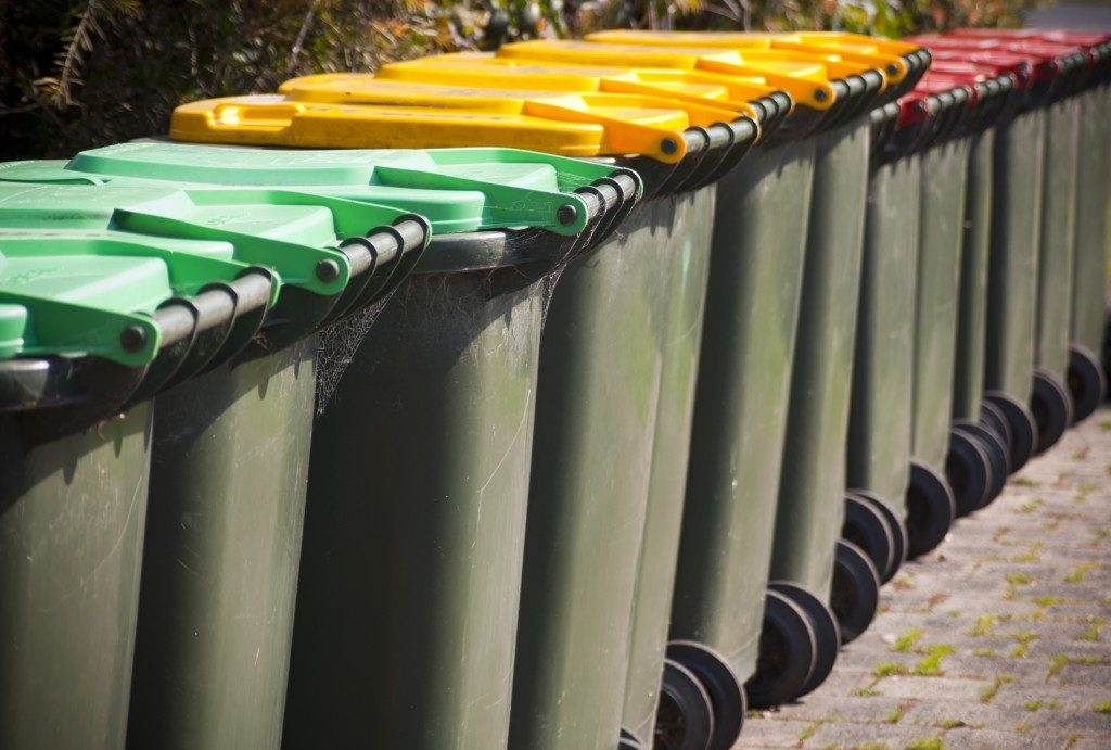 row of colorful recycling bins