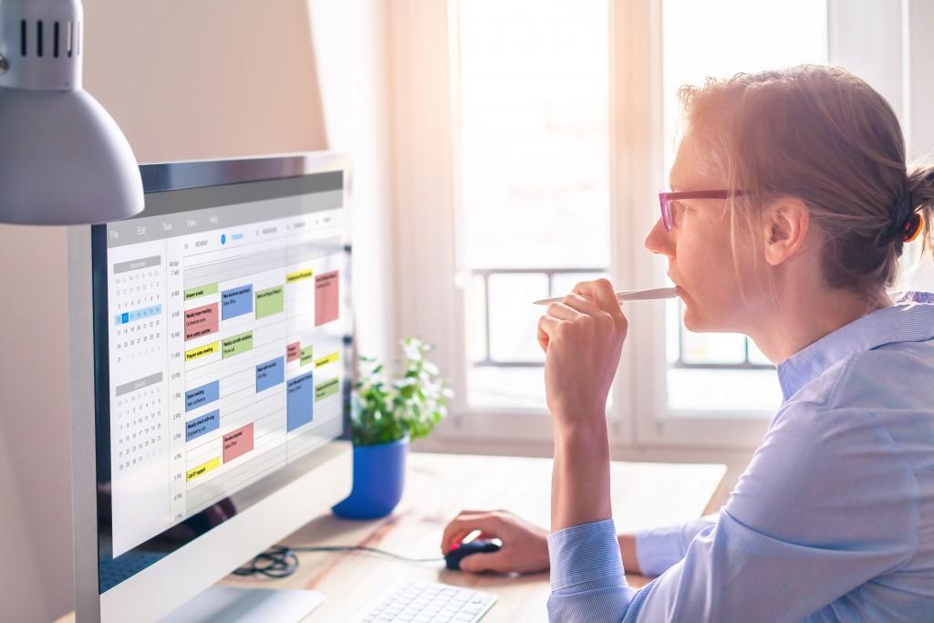 woman looking at a calendar