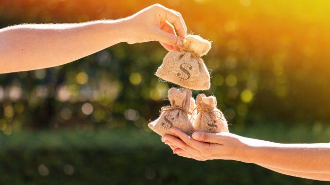 handing money bag