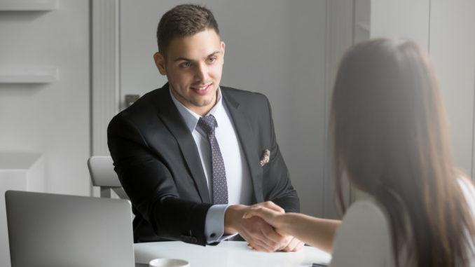 man shaking an applicant's hand