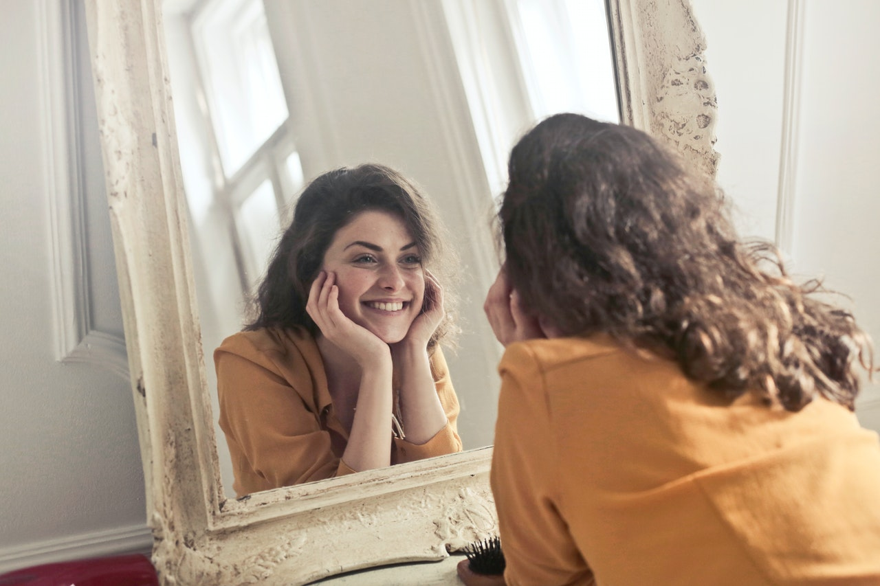 smiling in mirror