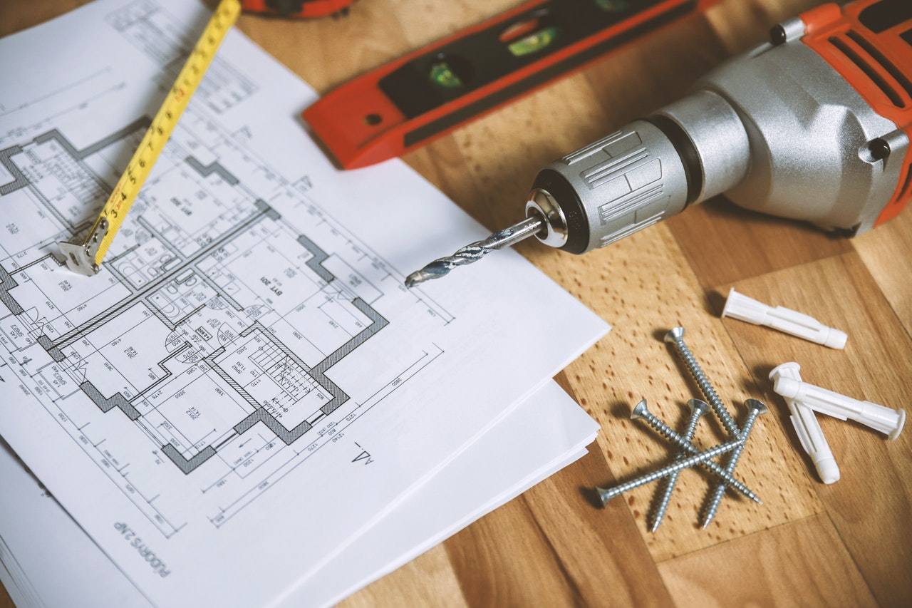 blueprints next to a drill