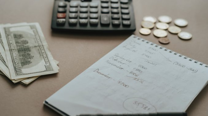 paper cash and calculator on a table