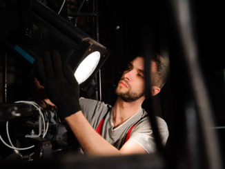 a person setting up a head light