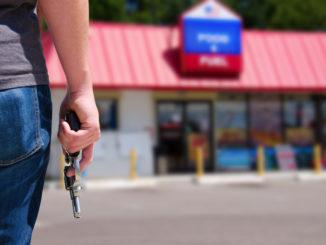 man robbing a local store
