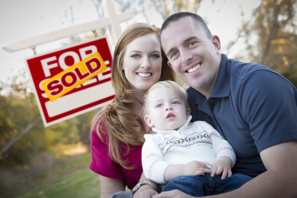 family behind a sold house